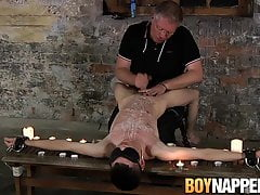 Young Aaron Aurora shoots cum after candle wax domination