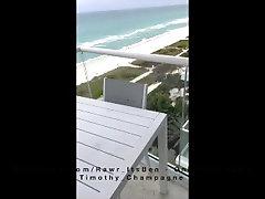Twink ItsBen fucks jock Timothy Champagne outside in public on a glass hotel balcony