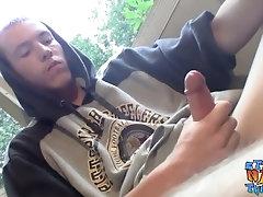 Homosexual thug takes a smoke outdoors and jacks off