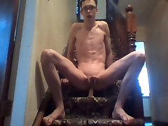 Very skinny twig penetrates his anus with a dildo on his stairs and moans